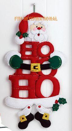 Bucilla ~ HO HO Ho Santa ~ Felt Christmas Wall Hanging Kit Bucilla felt applique kits are a Christmas tradition. The designer of this kit found a very clever way to use HO HO HO as the body of the Santa Wall Hanging kit. Christmas Sewing, Christmas Diy, Christmas Wreaths, Felt Christmas Ornaments, Christmas Stockings, Felt Decorations, Christmas Decorations, Holiday Decor, Felt Crafts