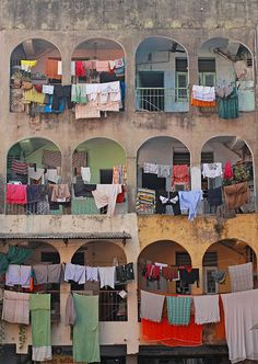 meanest indian, prayer flags, window, clotheslin, arches, color stories, city life, apartments, barcelona