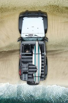 Jeep, Beach and a Surf Board, What's not to like.