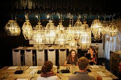Lenoir: Make sure to call for a reservation at this intimate local date spot. Sit underneath the glow of stunning glass lanterns or outside in the romantic wine garden.