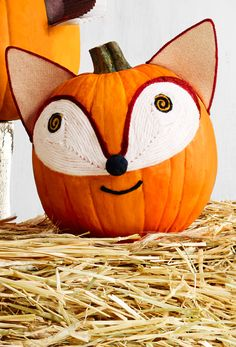 Put a friendly face on this clever fella with playful coiled yarn. Turning your pumpkin into an animal has never been as cute as this fox.