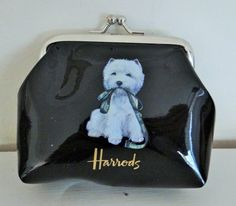 "A gift from my husband and, yet again, he hits a homerun. A cute dog, a change purse, and from Harrod's the beloved department store in London.  Parent Trap is one of my favorite movies (original and re-make) and in one scene Natasha Richardson, the Mom, tells her daughter, Lindsay Lohan, that they will go to lunch and then ""get lost in Harrods.""  Heaven."