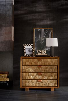 Natural beauty: hand-woven water hyacinth accents the modern teak frame of the Black Palms chest from Ralph Lauren Home
