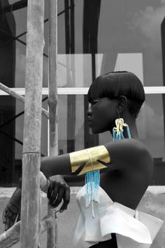 Supermodel Ajuma Nasenyana wearing earrings and a bangle with sky blue beads from our Anemone Collection.   Our jewelry looks exquisite!  Thanks to:  Model: Ajuma Nasenyana Clothing: Structured Crop Top by Anil Padia (upcoming Kenyan designer)  Photography: Barbara Minishi Styling: Lara Ubago Hair: Randolph Gray Make Up: Muthoni Njoba Production: Olivia Ambani