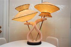 Wild-looking 1950's DuBarry chalkware lamp with fiberglass UFO shades.