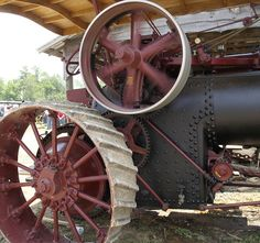 """Priscilla, """"Geiser Steam Powered Tractor"""", packs quite a bit  of power in her whirling pulley wheel.  The pully is about 5 feet in  diameter, and I would guess weighs at least 300 pounds, being cast  iron"""