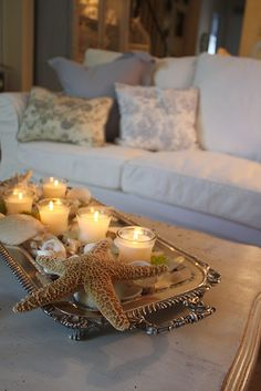 Coastal Living...shells and candles on a silver tray...lovely!