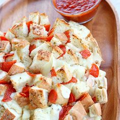 Made this for a book club and DDAYYUMMMM... so good. Defintely a 10 in my book !   Bloomin\' Pizza Bread  1 unsliced round sourdough bread loaf  16 oz. shredded mozz or provolone cheese 1 (3.5 ounce) pkg pepperoni, halved  3 Tbsp butter, melted  1/2 tsp garlic powder  1/2 tsp Italian seasonings  2 tbsp Parmesan cheese  pizza/marinara sauce for dipping