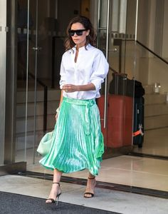 Victoria Beckham Button Down Shirt - Victoria Beckham was masculine-chic up top in a baggy white button-down from her own line while out and about in New York City.