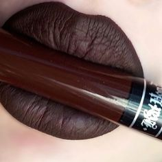 "Lip Swatch of @katvondbeauty liquid lipstick in ""DAMNED"" the most beautiful blackcherry lipstick I own! I love it!"