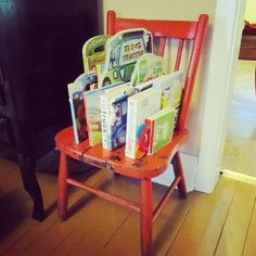 Reclaimed chair used as a bookshelf for kids books.