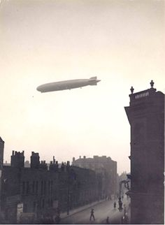 Zeppelin over Cotton Street, Poplar, Image courtesy of Tower Hamlets Local History Library and Archives. Victorian London, Vintage London, Old London, East London, London History, British History, Local History, London Live, London Architecture