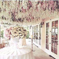 I love the idea of white and pale pink flowers falling from the ceiling.