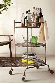 Love this cart, not sure what I could do with it though...I do have a bunch of candles, perfume, and pretty glass bottles, I'm sure they could fill it right up!
