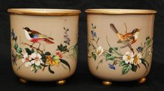 Pair of French enameled hand painted opaline glass footed pots depicting birds and flowers.
