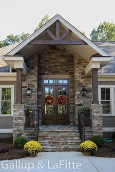 Similar front doors! This is a pretty entryway! I like how they used the wreat… Similar front doors! This is a pretty entryway! I like how they used the wreaths for decor Dream House Exterior, Exterior House Colors, Exterior Design, Stone On House Exterior, Exterior Siding, Brown House Exteriors, Exterior Paint Colors For House With Stone, Siding Colors For Houses, Gray Exterior