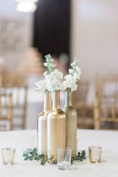 Beautiful DIY gold wine bottles for centerpieces. View the full wedding here: http://thedailywedding.com/2016/06/18/whimsical-lawn-wedding-katherine-matt/