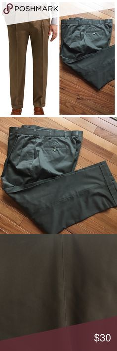 Men's pleated khakis Joseph A Bank travelers collection khakis. Cuffed bottom. 100 % cotton. Excellent condition, minor signs of wear around pocket edges and button. Olive green color. 38W x 29 L. Joseph A Bank Pants Chinos & Khakis