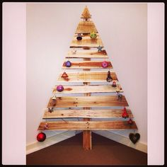 2014 Christmas tree! This year we made one out of pallet wood. recycled wood Christmas tree.