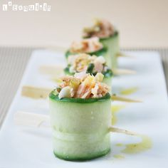 Cucumber rolls stuffed with salmon