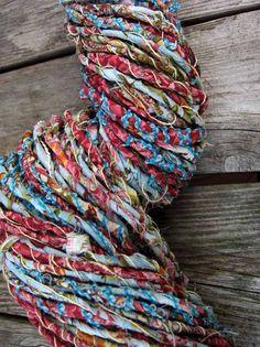 Raga yarns  fabric yarn? http://laughingpurplegoldfish.blogspot.com/2008/06/no-join-method-of-cutting-fabric-strips.html