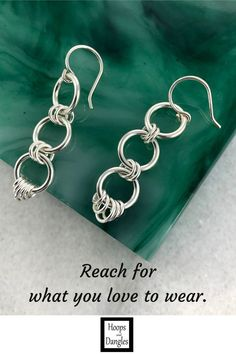 """Handmade 3 ring hoop dangles with a ringed accent are for you ear wire dangle wearers. Light, comfortable, and polished, these softened geometric shapes are made from sterling silver and good to go anywhere. SIZE: Total length including ear wire is 1 5/8"""" and Width is 3/8"""""""