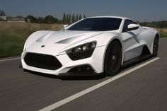 Zenvo ST1. Worth an abominable 1.8 million, this V8 turbocharged piece of flawless machinery measures 7 liters in engine capacity and delivers 1,250 HP.