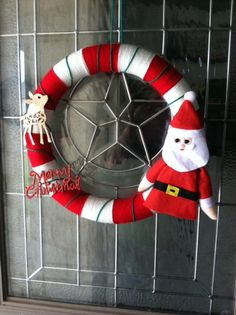 Playful Christmas Yarn Wreath by thebestintentions on Etsy, $28.00
