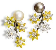 Blackened gold, natural pearl ear clips representing flowers on a branch, with yellow and white diamonds. Oliver Reza.