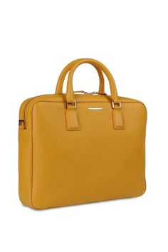 The essential accessory for a perfect business-ready outfit. This yellow business bag is a special version, exclusively available on the online boutique.