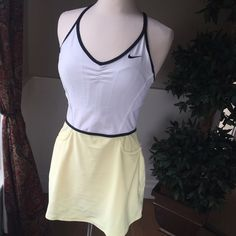 Nike Sharapova Tennis Dress This beautiful tennis dress has a shelf bra and mini A line skirt. This dress does not have the embroidery Sharapova sports on her dress, asides from that it's the same dress. No compression shorts. EUC and smoke free home. Nike Dresses Mini