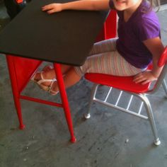 OLD school desk and chair that were rusted and in need of TLC...chalkboard paint for the top, chrome for the chair body, and red for the chair and bottom of desk...looks brand new! I LOVE spray paint!!