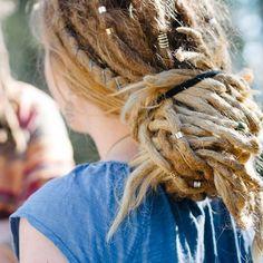 This dread lock bun knot is such a cute hair do! -myhippyhome.com