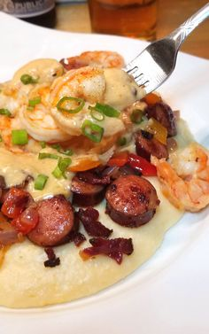 Yummmmalicious! Absolutely rich and delicious, this Shrimp and Grits recipe is right up there with many of the great restaurants in the Lowcountry! Southern Shrimp And Grits, Cajun Shrimp And Grits, Cajun Recipes, Shrimp Recipes, Cooking Recipes, Cajun Cooking, Grits Recipe, Shrimp Dishes, Comfort Food