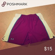 Pair of ladies Under Armor workout shorts Size medium ladies Under Armor workout shorts in burgundy with white sides and teal accents. Never worn. Under Armour Shorts