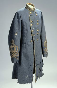 CONFEDERATE STAFF, BLUE-GREY WOOL, BUFF PIPING, BRIGADIER GENERAL'S BUTTON GROUPING, SLEEVE BRAID AND COLLAR INSIGNIA. BUTTONS - CONFEDERATE STAFF, RED SILK SASH, WORN BY MAJ. GEN. ROBERT F. HOKE, NC STATE TROOPS.  NC Museum of History