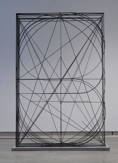 A layered alphabet, in steel.