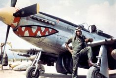 """Lieutenant Daniel """"Chappie"""" James poses with his Mustang in Korea. James would later go on to become the first black General in the US Air Force. B 17, Ww2 Aircraft, Military Aircraft, Aircraft Carrier, Pin Up, Close Air Support, Vintage Mustang, Tuskegee Airmen, Korean Air"""