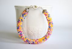 Beaded bracelet in pink, yellow and blue by BibaStore on Etsy Candy Bracelet, Beaded Bracelets, Pink Yellow, Blue, Jewelry Patterns, My Etsy Shop, Handmade Items, Bangles, Store