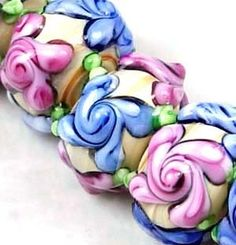 * Primrose Blossom Lampwork Glass Beads. Starting at $5 on Tophatter.com!