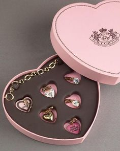 Juicy Couture charm bracelet and heart charms.