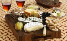 Cheese platter with bread, wine and fruits