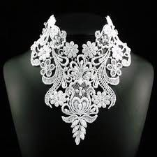 Large lace chocker. I imagine this would be nice with an off the shoulder Wedding dress.
