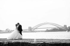 @inlightenphotography are experts at capturing Sydney couples against the backdrop of the glistening harbour! #australian #weddingphotographer #sydneywedding #localtalent #australianwedding  Photo by @inlightenphotography / gown by @eternalbridal by modernweddingmagazine