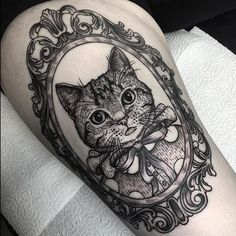 cat frame tattoo