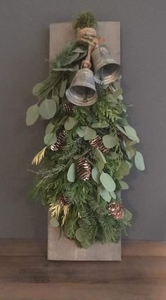 Nice shape. It would be much quicker and simpler to make than a round wreath. I think it needs the bells or a big bow though.