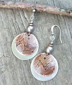 Hand etched copper and brushed silver disc backing w/ antiqued silver and copper accents.