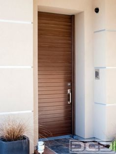 Horizontal Wood Slat Courtyard Entry Gate in a Modern Architectural Design by Dynamic Garage Door Call for information: (714) 900-DOOR by DynamicGarageDoors