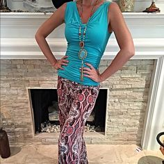 Gorgeous flattering fit turquoise top! ALMOST GONE Pretty drape front and ruche sides makes this piece- dip in back with band across top! One of my favorite pieces!  Follow me on Instagram @kfab333 for more items😊 Tops Tank Tops