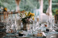 Late spring blooms in the birch and jute-wrapped centerpieces filled with fresh-cut flowers at Samantha and Richard's Audubon wedding: Love Me Do Photography.